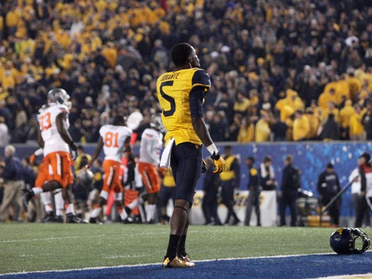 West Virginia wide receiver Jovon Durante (5) stands on the goal line after West Virginia lost to Oklahoma State in overtime of an NCAA college football game Saturday, Oct. 10, 2015, in Morgantown, W.Va. Oklahoma State defeat West Virginia 33-26. (AP Photo/Raymond Thompson)