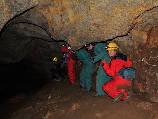Team members head deeper into the cave.