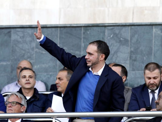 Prince Ali of Jordan waves at fans of the national team during the 2018 FIFA World Cup, Group B, qualifying soccer match between Jordan and Australia in Amman, Jordan, Thursday, Oct. 8 , 2015. (AP Photo/Raad Adayleh)