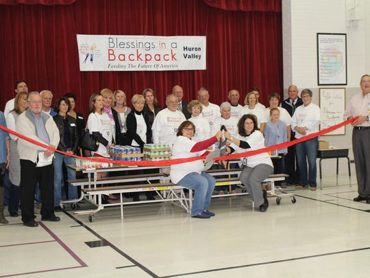 The Huron Valley Chamber of Commerce got involved with the Blessings in a Backpack program with a ribbon cutting ceremony to mark its start.