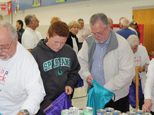 Milford Township Supervisor Don Green, right, was among the volunteers with Blessings in a Backpack.