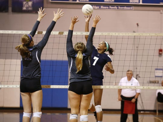Maclay's Jewel Strawberry spikes a ball as P.K. Yonge's Amanda Phegley, left, and Sammy Mueller defend the point during their Region 1-3A final on Tuesday. Strawberry had eight kills and 13 digs in the Marauders' loss, but she is back for the next two years along with nearly everyone else.