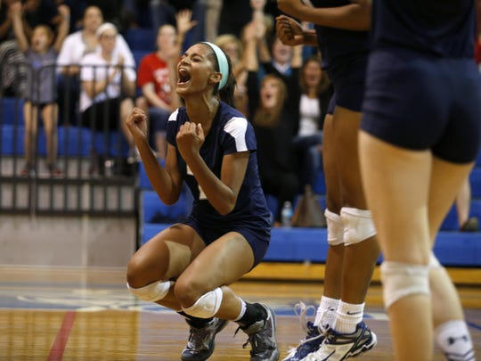 Maclay's Jewel Strawberry celebrates winning a point with her team during their Region 1-3A home game against P.K. Yonge on Tuesday. Strawberry had eight kills for the Marauders, which return all but one player for next year.