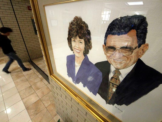 A portrait of Sue and Joe Paterno by artist Bill Rettig hangs in the Pattee and Paterno Library on the main campus of Penn State University in State College.