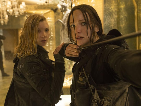 """This image released by Lionsgate shows Natalie Dormer as Cressida, left, and Jennifer Lawrence as Katniss Everdeen in a scene from """"The Hunger Games: Mockingjay Part 2."""" (Murray Close/Lionsgate via AP)"""