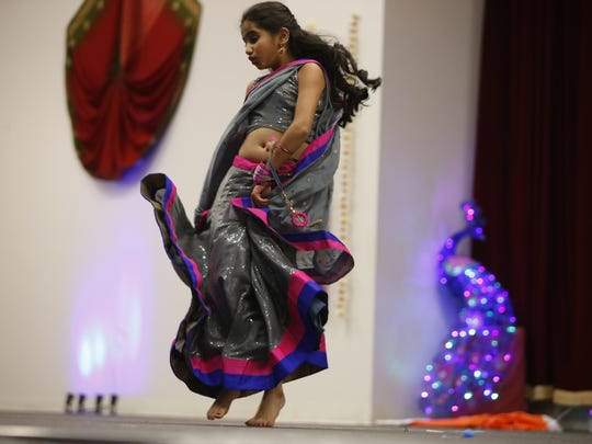 Khushi Patel, 8, performs Ghagra, a solo dance for the Diwali celebration at Hindu Temple Gujarati Samaj of Tallahassee.
