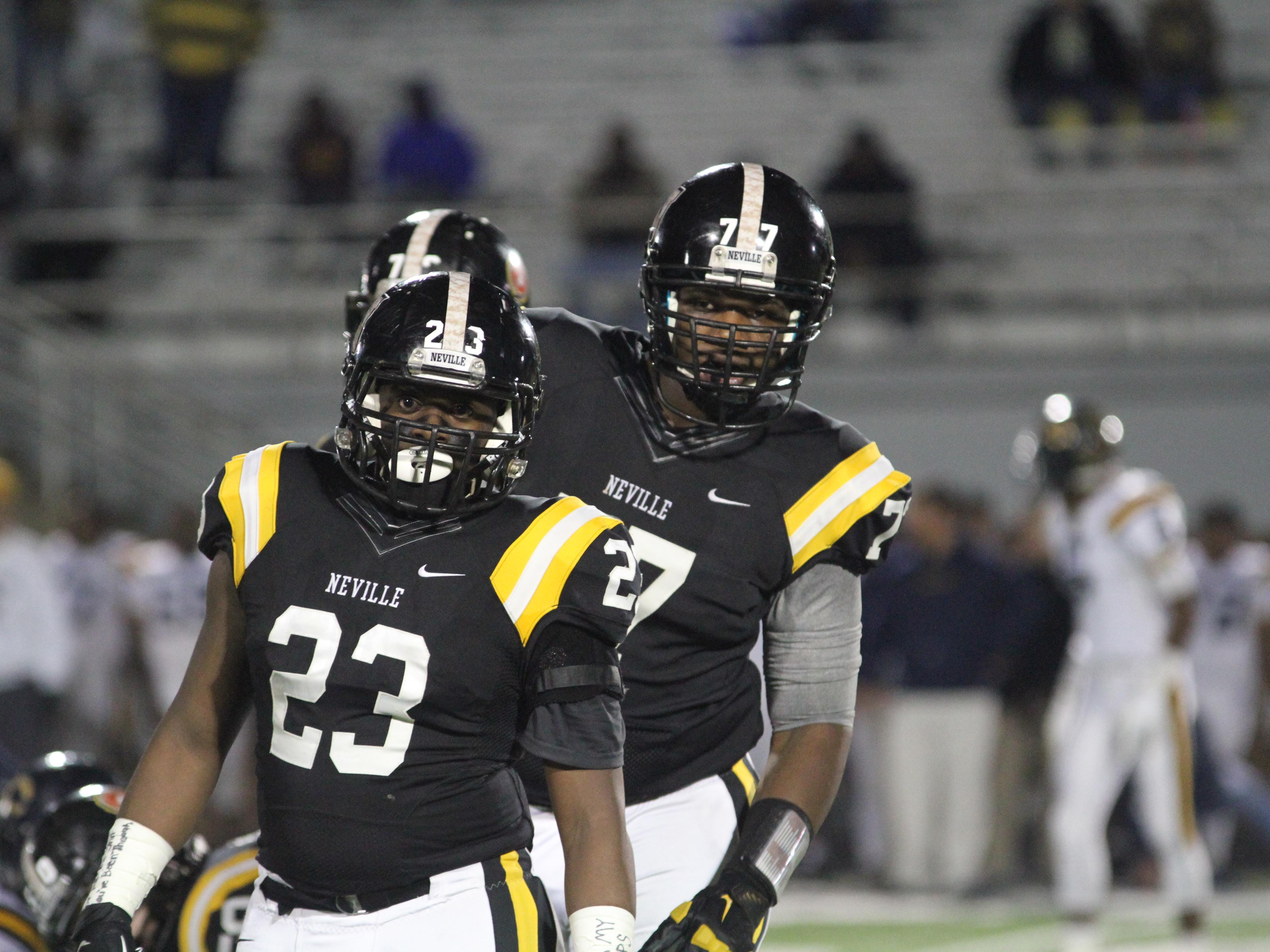 Neville's William Wooten (23) and Joctavis Phillips (77) await a play against the Carencro Bears on Friday night in Monroe.