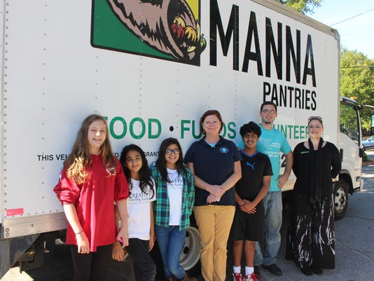CLA's head of school with students at CLA Manna Food Drive