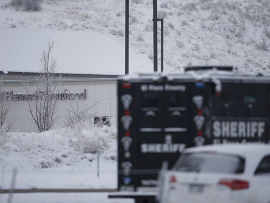Police investigate at a Planned Parenthood clinic and area around the building north of a strip mall early Saturday, Nov. 28, 2015, in northwest Colorado Springs, Colo.