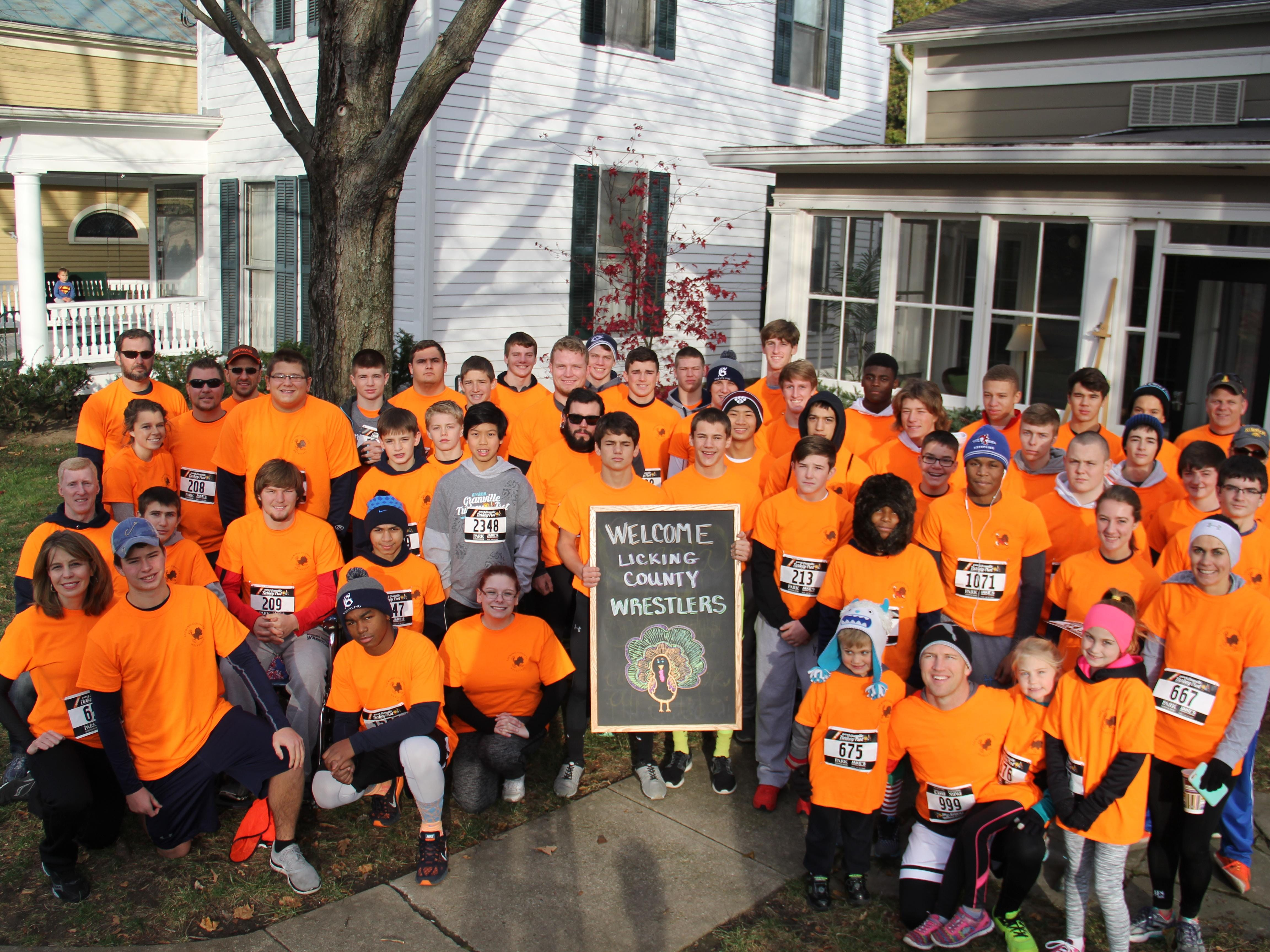 A group of wrestlers from Granville, Licking Valley and Newark high schools participated in the Granville Turkey Trot on Thursday to raise money for the Food Pantry of Licking County.