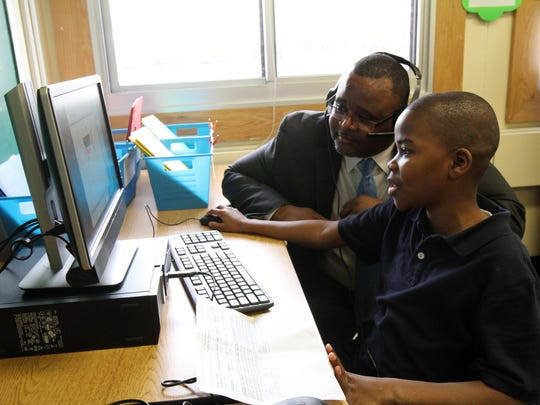 Lamont Repollet, superintendent of Asbury Park School District, listens to Marckenley St. Surin, 12, talk about a computer lesson in his ESL class at Asbury Park Middle School in Asbury Park, NJ Monday November 30, 2015