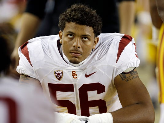 Southern California linebacker Anthony Sarao (56) looks on from the bench in the final minutes of a 41-22 loss to Stanford during the second half of a Pac-12 Conference championship NCAA college football game Saturday, Dec. 5, 2015, in Santa Clara, Calif. (AP Photo/Ben Margot)