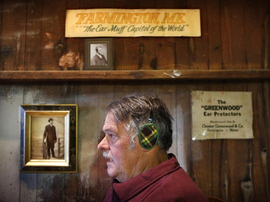 Ronald Greenwood, a great-grandson of earmuff inventor Chester Greenwood, models a pair of original ear protectors in his barn in Farmington, Maine.