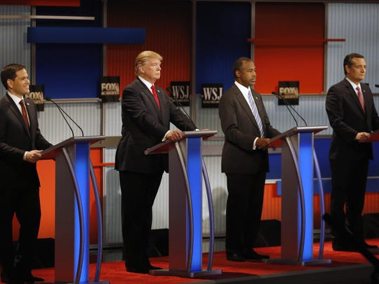In this Nov. 10, 2015, file photo, Republican presidential candidates, from left, Sen. Marco Rubio, R-Fla., Donald Trump, Ben Carson and Sen. Ted Cruz, R-Texas, wait before the Republican presidential debate at the Milwaukee Theatre in Milwaukee.