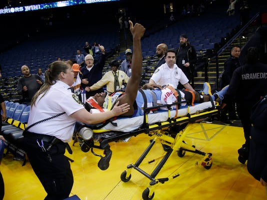 Denver Nuggets forward Kenneth Faried is taken off the court on a stretcher after an injury at the end of an NBA basketball game against the Golden State Warriors on Saturday, Jan. 2, 2016, in Oakland, Calif. (AP Photo/Marcio Jose Sanchez)