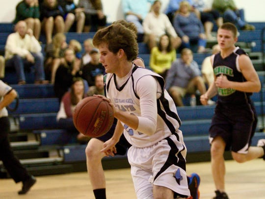 Brian Flynn leads a fast break in Marco Island Academy's runaway win Monday night. Flynn scored six points for the Rays.