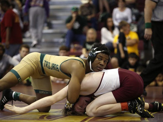 Lincoln's David Jackson and Florida High's Jake Richardson wrestle in the 145-pound division during the Seminole Wrestling Classic at Florida High on Saturday.