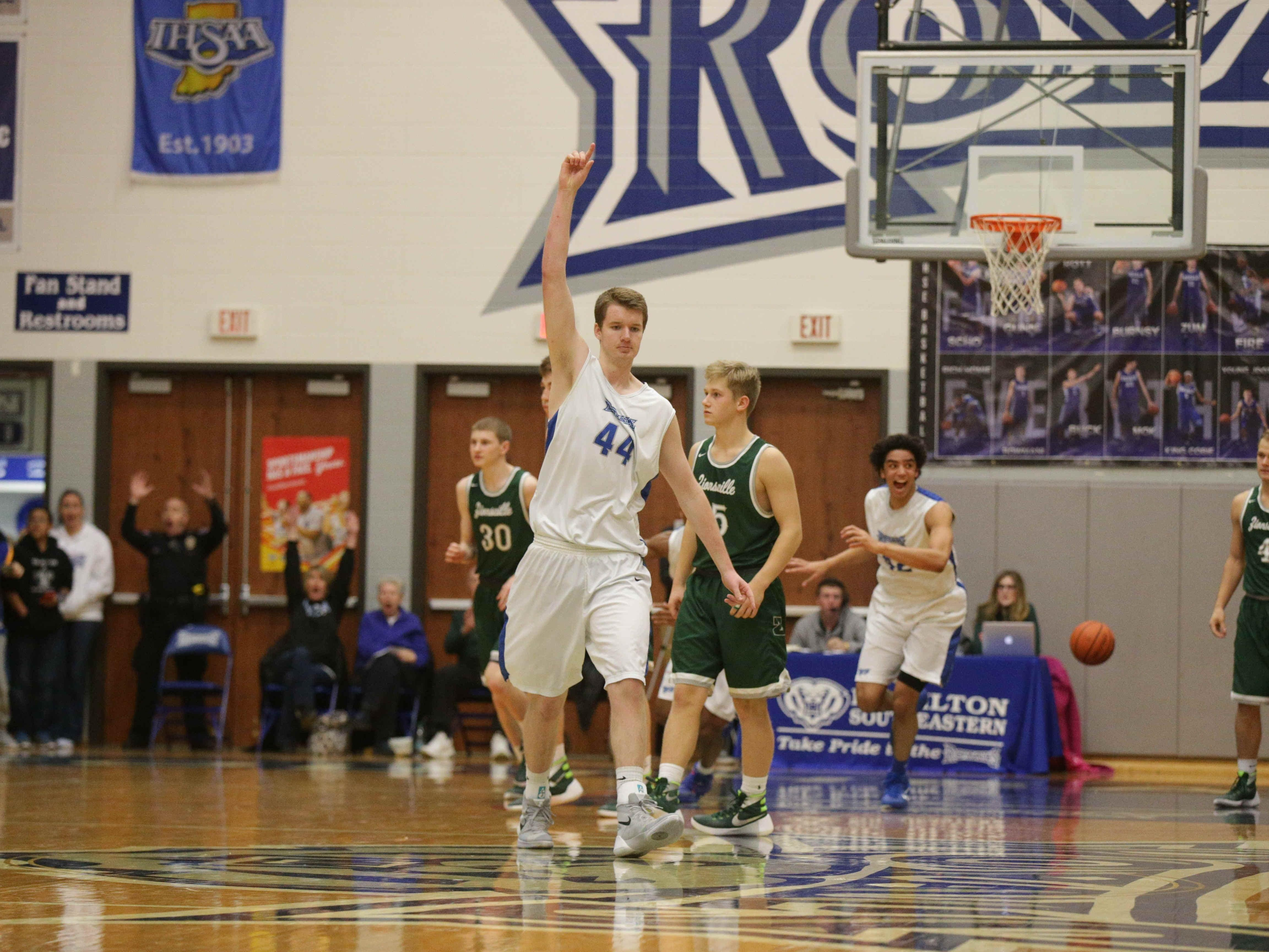 The Royal's #44, Brennan Schofield celebrates after hitting a three point shot at the buzzer for the win, Friday January 22nd, 2016. Hamilton South Eastern VS Zionsville at HSE. Royals win 48-47. #30 Dominick Genco, #5 Jordan Cox, #42 Zach Guzz, #4 Jack Pilcher.