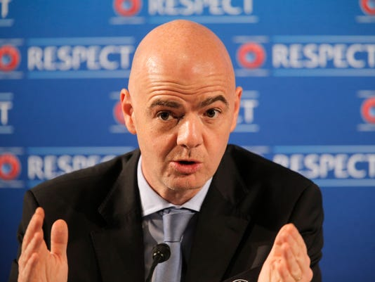 FILE - In this Feb. 22, 2014 fiel photo UEFA General Secretary Gianni Infantino gestures during a press conference, one day prior to the UEFA EURO 2016 qualifying draw in Nice, southeastern France. Infantino used his manifesto, which was published Tuesday, Jan. 19, 2016, to say FIFA should not limit the tournament to be being held in one or two countries. (AP Photo/Lionel Cironneau, file)
