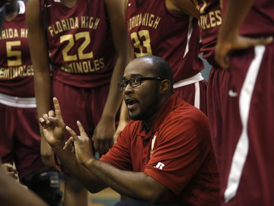 Florida High head coach Daryl Marshall talks to his team during a timeout in their game against FAMU DRS on Saturday.
