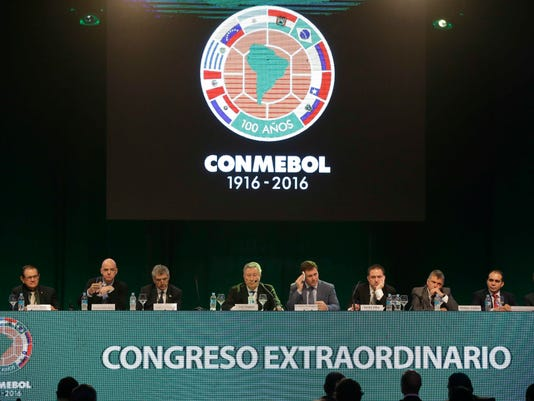 Paraguayan Alejandro Dominguez, center, dries sweat from his temple, during an extraordinary session of CONMEBOL, the South American football federation, in Luque, Paraguay, Tuesday, Jan. 26, 2016. Representatives elected Dominguez as their new president, replacing Angel Napout. (AP Photo/Cesar Olmedo)