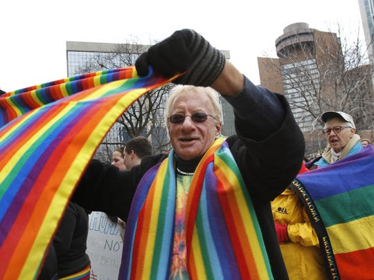 Gary Gould, Indianapolis, waves a rainbow flag during the pro-gay rights rally on the south steps of the Indiana Statehouse on Monday, March 14, 2011. A couple hundred people attended the noon rally, put on by Indiana Equality Action and Rally for Equality in opposition of House Joint Resolution 6 (HJR6), the proposed amendment that only marriage between one man and one woman would be valid or recognized as a marriage in Indiana. Charlie Nye / The Star.