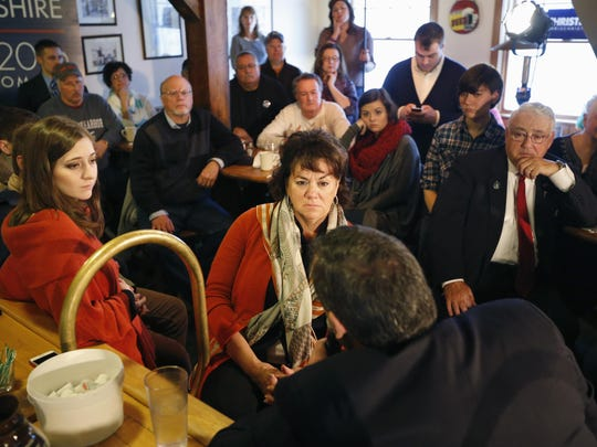 People listen as Republican presidential candidate, New Jersey Gov. Chris Christie speaks at a town hall-style campaign stop, Friday, Feb. 5, 2016, at the Strafford Farms Restaurant in Dover, N.H. (AP Photo/Robert F. Bukaty)
