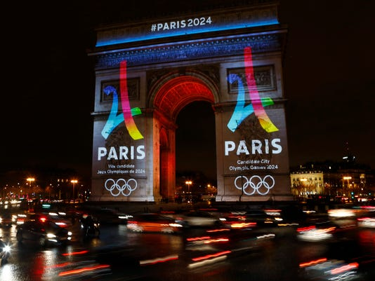 The Eiffel Tower-shaped bid logo for the Paris 2024 is unveiled on The Arc of Triomphe on the Champs Elysees in Paris, France, Tuesday, Feb. 9, 2016. Leaders of the Paris bid for the 2024 Olympics boosted their public campaign on Tuesday as they secured about 8 million euros ($8.9 million) in sponsorship deals with four major French groups. (AP Photo/Francois Mori)