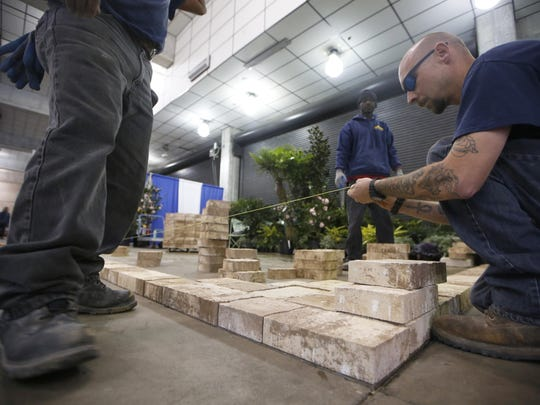 Scott Sullivan, right, and fellow crew members from Keystone Design set up a patio display at the Tucker Civic Center for a previous North Florida Home Show, which is Feb. 8-10 this year.