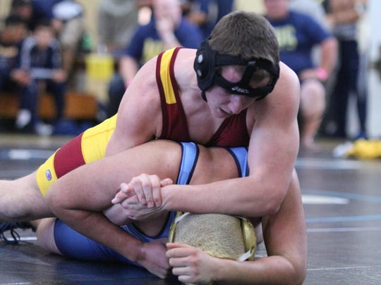Tulare Union's Phillip Sicks, top, was the East Yosemite League individual champion at 195 pounds.