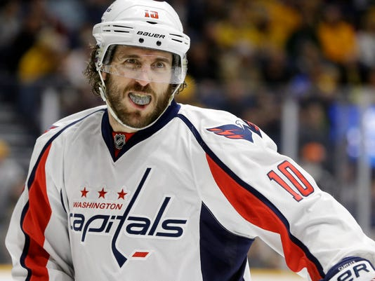 """FILE - In this Feb. 9, 2016, file photo, Washington Capitals center Mike Richards plays against the Nashville Predators in the first period of an NHL hockey game in Nashville, Tenn. Los Angeles Kings general manager Dean Lombardi thought he found his """"Derek Jeter"""" in Mike Richards. The center won two Stanley Cups for the Kings, but his game went downhill and the team bought him out last summer after an arrest for possession of a controlled substance. Richards, now with the Washington Capitals, faces his former team Tuesday, Feb. 16, 2016,  holding no particular grudge. (AP Photo/Mark Humphrey, File)"""
