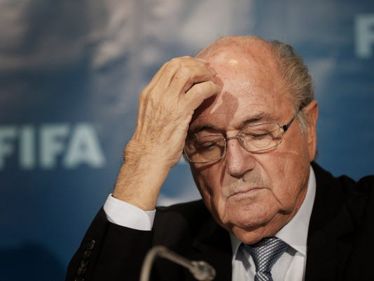 FILE - In this Dec. 19, 2014 file photo FIFA President Sepp Blatter gestures as he attends a news conference in Marrakech, Morocco. Sepp Blatter was back at FIFA headquarters  in Zurich for what could be the last time on Tuesday, Feb. 16, 2016 , challenging his eight-year ban for approving a $2 million payment to Michel Platini in 2011.   (AP Photo/Christophe Ena, File)