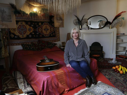 Kathy Etchingham, the former girlfriend of Jimi Hendrix, attends a media preview in the bedroom of his former central London flat. The flat opens to the public as a permanent exhibition Wednesday.