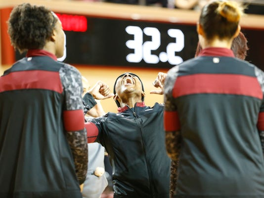 South Carolina guard Khadijah Sessions, center, dances and cheers with teammates before an NCAA college basketball game against Alabama, Monday, Feb. 22, 2016, in Tuscaloosa, Ala.  (AP Photo/Brynn Anderson)