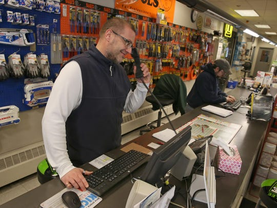 Jeff Goossen, sales representative, takes an order over the phone at the customer counter at Kovalsky Carr Electric Supply Company in downtown Rochester Thursday, Feb. 25, 2016.