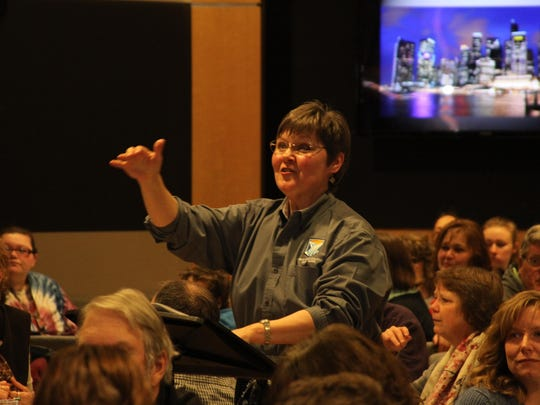 Cynthia Stevens directs the Great Falls College Community Choir during a recent Feast of Sweets event.