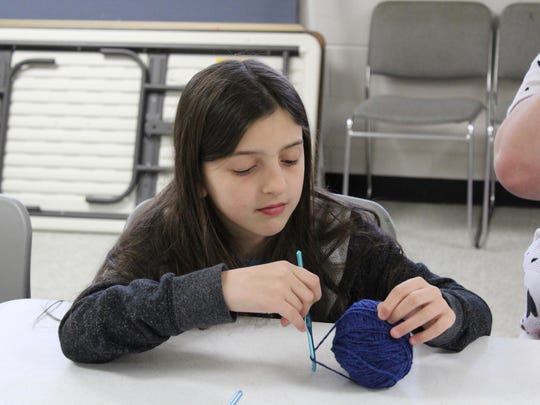 Lily Olive, 9, learns how to crochet.