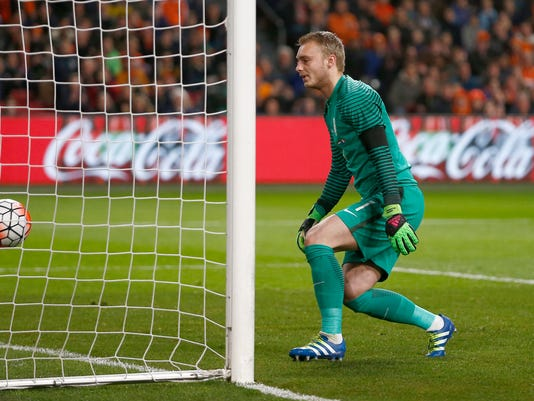 Netherlands' goalkeeper Jasper Cillessen watches the ball go into the net after France's Antoine Griezmann scored his side's first goal during a international friendly soccer match between The Netherlands and France at the ArenA stadium in Amsterdam, Netherlands, Friday, March 25, 2016. (AP Photo/Peter Dejong)
