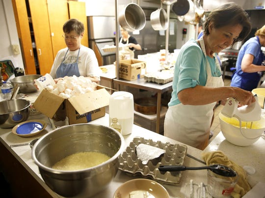 Joann Sapolsky, right, and Joy Ellsworth work to create the 25 pans worth of Kugel for the thousands of expected attendees of Temple Israelâ's 7th Annual Tallahassee Jewish Food and Cultural Festival.