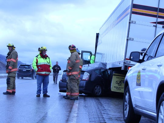 """A 21-year-old California woman walked away with minor scratches from a crash on Interstate 15 on Saturday near mile marker 36, said Utah Highway Patrol Sgt. Larry Mower. """"She was driving her Toyota Prius a little too fast for the rain conditions that existed,"""" he said. """"She was trying to pass a semi over the Black Ridge and swerved to the left and hit the concrete barrier, then her car went to the right underneath the back wheels of a semi-truck. It was amazing that her only injuries were scratches from the broken glass."""" The female was the only occupant of the Prius, Mower said, and nobody from the semitrailer was injured."""
