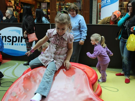 Laceyray Cowart, 5, of Pittsgrove, tries out the tomato slide in the new Inspira Play Zone.