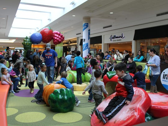 Children and parents pack into the new Inspira Play Zone in the Cumberland Mall on Saturday.