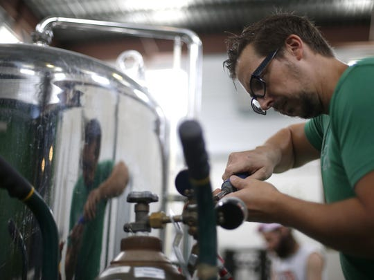 Gabe Grass works on GrassLands's Shakesbeer brew, their G-Street Kolsch infused with wormwood created especially for this weekend's Shakespeare festival.