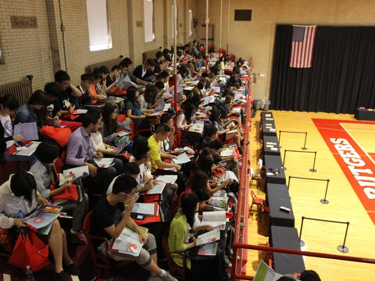 Rutgers students attend an orientation in August 2013 at the College Avenue Gym.