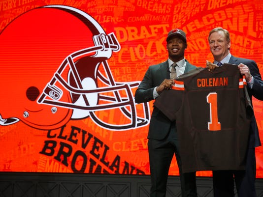 Baylor's Corey Coleman poses for photos with NFL commissioner Roger Goodell after being selected by Cleveland Browns as the 15th pick in the first round of the 2016 NFL football draft, Thursday, April 28, 2016, in Chicago. (AP Photo/Charles Rex Arbogast)