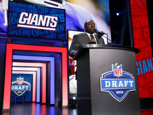 Former NFL player Rodney Hampton announces that the New York Giants selects Oklahoma's Sterling Shepard as the 40th pick in the second round of the 2016 NFL football draft, Friday, April 29, 2016, in Chicago. (AP Photo/Charles Rex Arbogast)