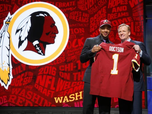 TCU's Josh Doctson poses for photos with NFL commissioner Roger Goodell after being selected by Washington Redskins as the 22nd pick in the first round of the 2016 NFL football draft, Thursday, April 28, 2016, in Chicago. (AP Photo/Charles Rex Arbogast)