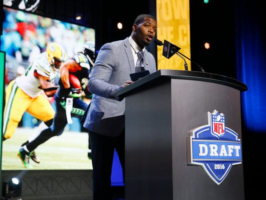 Former Walter Payton Men of the Year Sam Barrington announces that the Green Bay Packers selects Utah State's Kyler Fackrell as the 88th pick in the third round of the 2016 NFL football draft, Friday, April 29, 2016, in Chicago. (AP Photo/Charles Rex Arbogast)