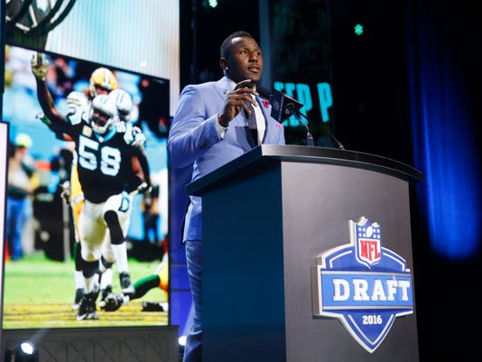 Former Walter Payton Men of the Year Thomas Davis announces that the Carolina Panthers selects West Virginia's Daryl Worley as the 77th pick in the third round of the 2016 NFL football draft, Friday, April 29, 2016, in Chicago. (AP Photo/Charles Rex Arbogast)