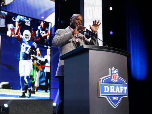 Former Walter Payton Men of the Year Reggie Wayne announces that the Indianapolis Colts selects Texas Tech's Le'Raven Clark as the 82nd pick in the third round of the 2016 NFL football draft, Friday, April 29, 2016, in Chicago. (AP Photo/Charles Rex Arbogast)